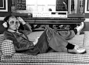 <p>Elton John listening to music on Sony hi-fi equipment in 1974.</p>