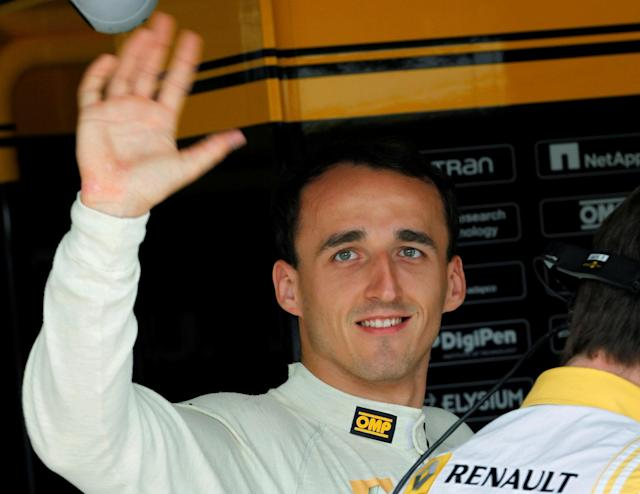 FILE PHOTO: Renault Formula One driver Robert Kubica of Poland arrives in his box during the second practice session for the Hungarian F1 Grand Prix at the Hungaroring circuit near Budapest July 30, 2010. REUTERS/Leonhard Foeger/File Photo
