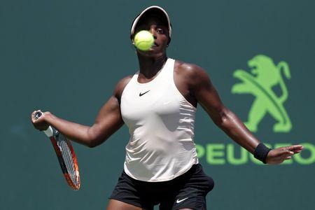 Mar 29, 2018; Key Biscayne, FL, USA; Sloane Stephens of the United States hits a forehand against Victoria Azarenka of Belarus (not pictured) in a women's singles semi-final of the Miami Open at Tennis Center at Crandon Park.  Mandatory Credit: Geoff Burke-USA TODAY Sports