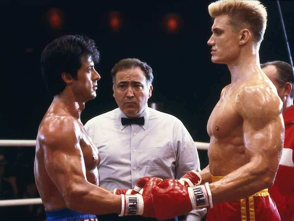 Fight face: Sylvester Stallone and Dolph Lundgren in Rocky IV (Rex)