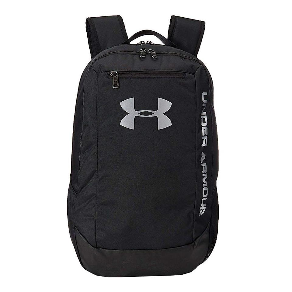 """<p><strong>Under Armour</strong></p><p>amazon.com</p><p><a href=""""https://www.amazon.com/dp/B06XGQX6YM?tag=syn-yahoo-20&ascsubtag=%5Bartid%7C2089.g.1214%5Bsrc%7Cyahoo-us"""" rel=""""nofollow noopener"""" target=""""_blank"""" data-ylk=""""slk:Shop Now"""" class=""""link rapid-noclick-resp"""">Shop Now</a></p><p>This backpack from Under Armour comes in a plethora of colors, all of which are water-resistant. It comes complete with a laptop sleeve, a side water bottle pouch, and a front zipper to hold and protect all your valuables.</p>"""