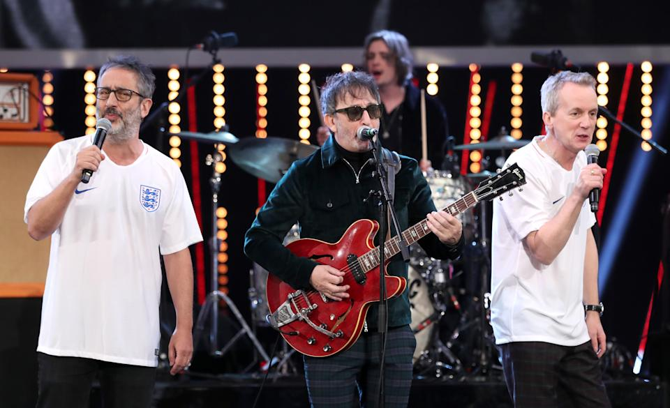 Baddiel and Skinner's Euro 96 hit (seen here performing Three Lions in 2018 with Ian Broudie) topped the UK charts a record four times. (Getty)