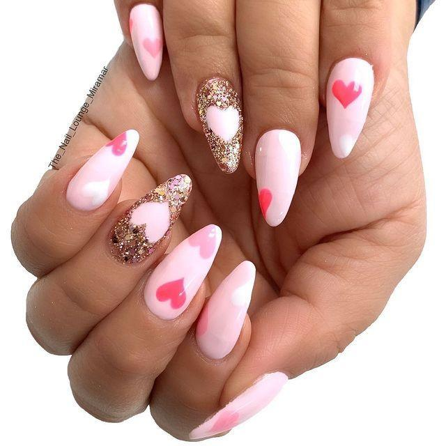 """<p>The addition of a gold glitter accent nail with a pale pink heart in the center makes this manicure Instagram-worthy.</p><p><a href=""""https://www.instagram.com/p/B708l7wgx7q/"""" rel=""""nofollow noopener"""" target=""""_blank"""" data-ylk=""""slk:See the original post on Instagram"""" class=""""link rapid-noclick-resp"""">See the original post on Instagram</a></p>"""