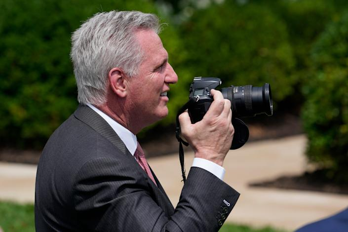 House Minority Leader Kevin McCarthy, R-Calif., holds the camera of Sen. Patrick Leahy, D-Vt., during an event in the Rose Garden of the White House in Washington, Monday, July 26, 2021, to highlight the bipartisan roots of the Americans with Disabilities Act and marking the law's 31st anniversary.