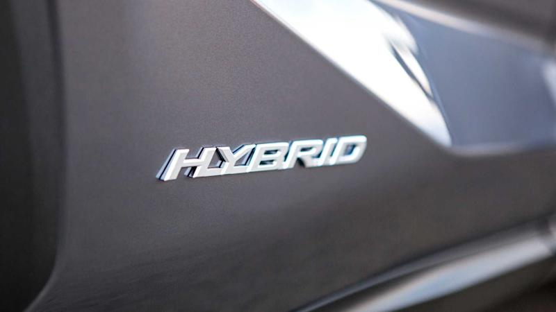 Close up of hybrid nameplate on car body