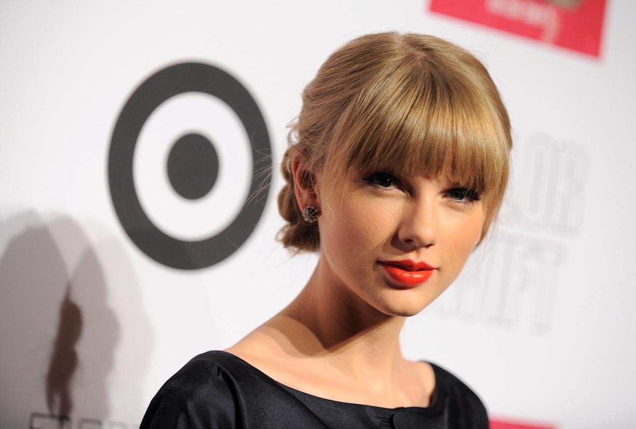 "IMAGE DISTRIBUTED FOR TARGET - Taylor Swift and Target celebrate the Target Deluxe Exclusive Edition of ""Red"" on Monday, Oct. 22, 2012, in New York. (Photo by Jordan Strauss/Invision for Target/AP Images)"