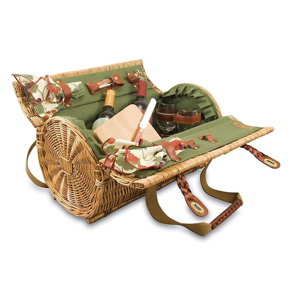 <p>This <span> Picnic Time Verona Insulated Wine Basket </span> ($100) has everything you need for a full spread.</p>