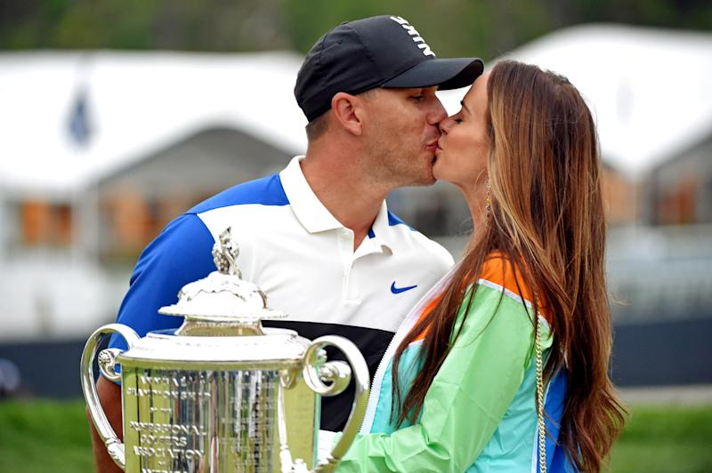 Brooks Koepka celebrates winning the PGA Championship with a long-awaited kiss from his girlfriend, Jena Sims.