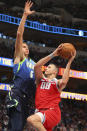 Dallas Mavericks forward Kristaps Porzingis (6) tries to defend against a shot by Sacramento Kings forward Nemanja Bjelica (88) in the second half of an NBA basketball game Sunday, Dec. 8, 2019, in Dallas. (AP Photo/Richard W. Rodriguez)