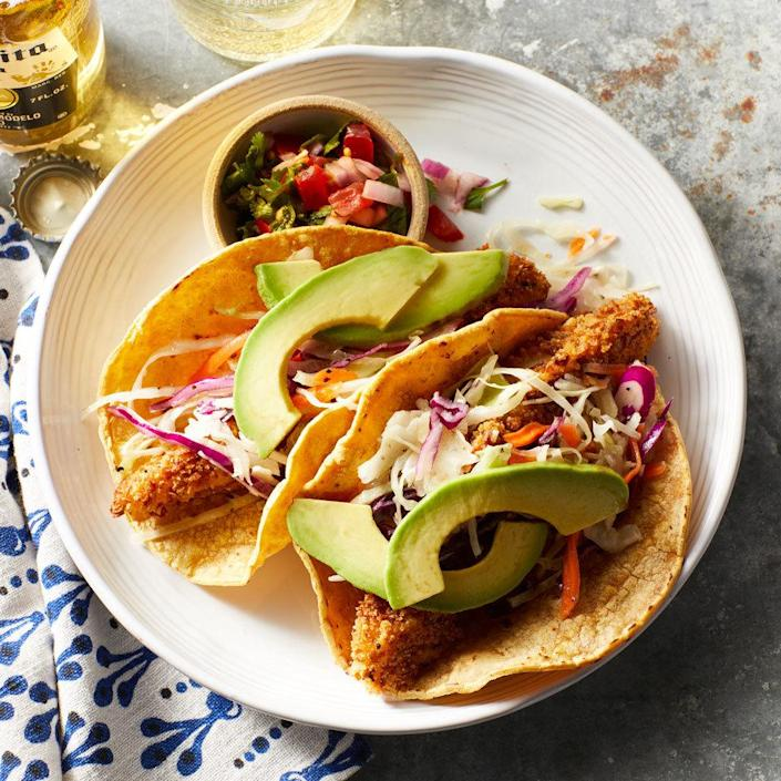 <p>Fish tacos make a satisfying meal the entire family will love. Many restaurant versions are deep-fried, but our technique includes coating the fish in a seasoned whole-grain breading and spritzing it lightly with cooking spray before baking on a rack until golden brown. The result is a crispy exterior with moist and flaky fish inside.</p>