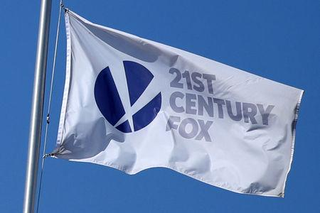 Century Fox Studios flag flies over the company building in Los Angeles