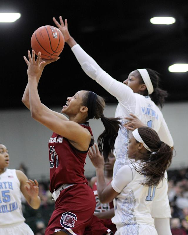 South Carolina's Asia Dozier (31) goes up for a layup as North Carolina defender Stephanie Mavunga (1) attempts to block during an NCAA college basketball game in Myrtle Beach, S.C., Wednesday, Dec. 18, 2013. (AP Photo/Willis Glassgow)