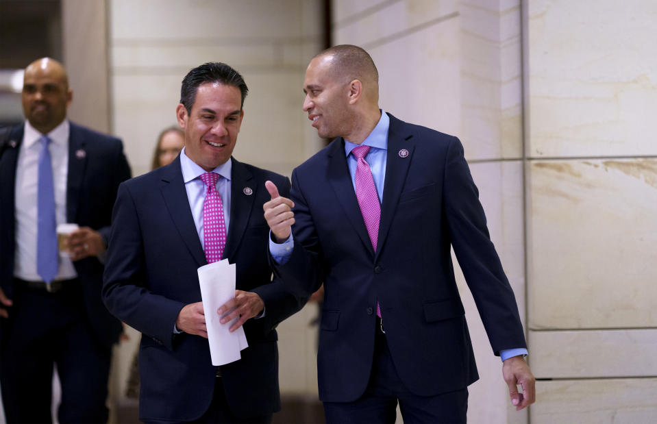 House Democratic Caucus Chair Hakeem Jeffries, D-N.Y., center, and and Vice Chair Rep. Pete Aguilar, D-Calif., left, arrive to speak to reporters after a meeting with Biden administration officials to discuss progress on an infrastructure bill, at the Capitol in Washington, Tuesday, June 15, 2021. (AP Photo/J. Scott Applewhite)