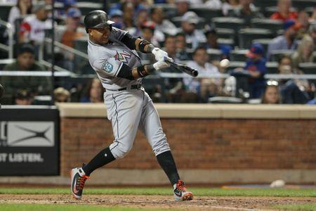 May 23, 2018; New York City, NY, USA; Miami Marlins second baseman Starlin Castro (13) hits an RBI single against the New York Mets during the ninth inning at Citi Field. Mandatory Credit: Brad Penner-USA TODAY Sports