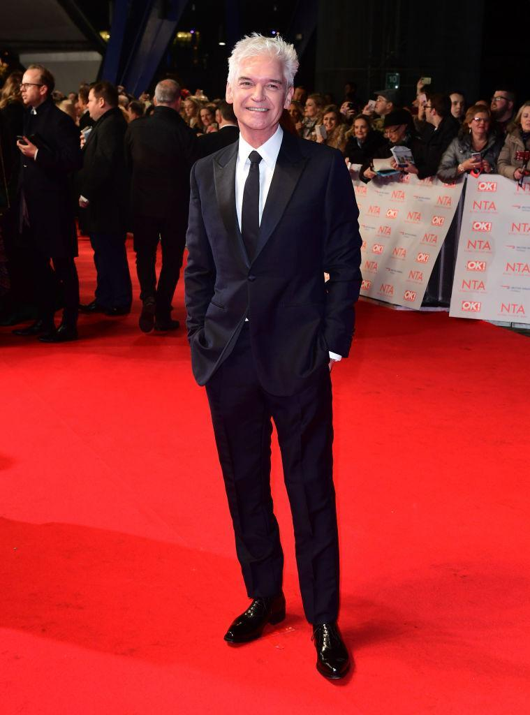 <p>The nation's favourite presenter looked smart in a sleek monochrome suit. <em>[Photo: Getty]</em> </p>
