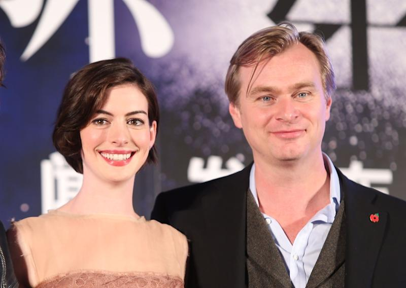 "Anne Hathaway and director Christopher Nolan promote ""Interstellar"" in 2014.  (Photo: VCG via Getty Images)"