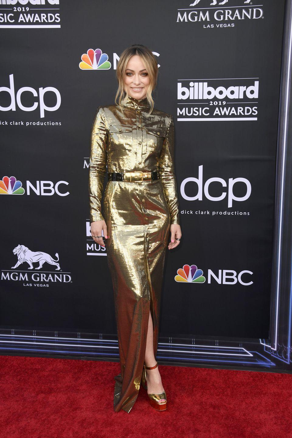 <p>Not one to be outshone by the bright lights of Las Vegas, the actress/director wore a floor-length gold dress with a knee-high slit, teamed with a black belt and gold detailing. </p>