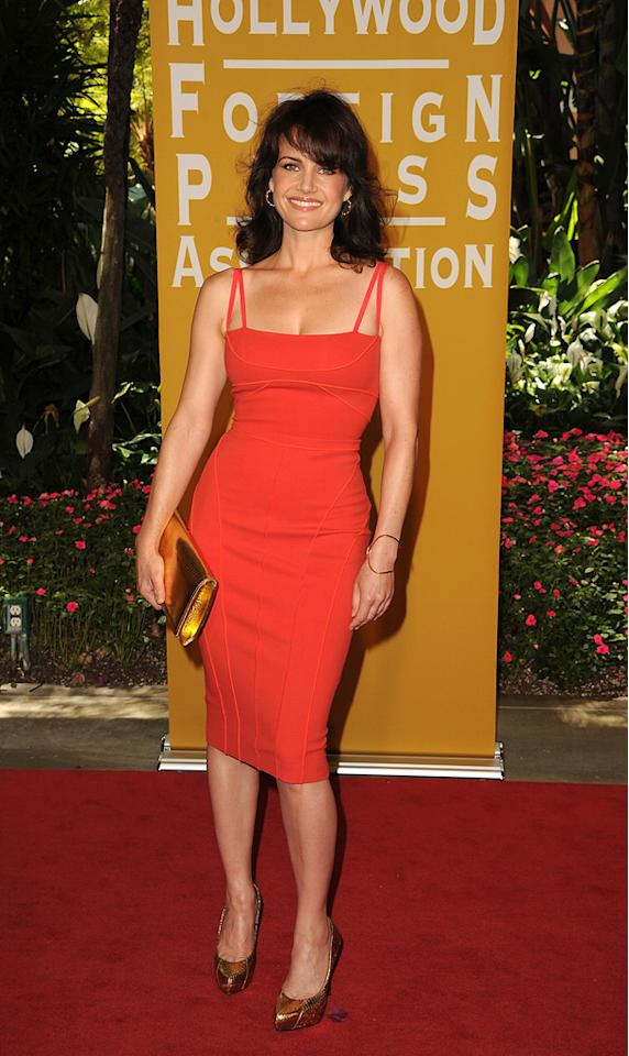 Carla Gugino arrives at the Hollywood Foreign Press Association's 2012 Luncheon held at the Beverly Hill Hotel on August 9, 2012.