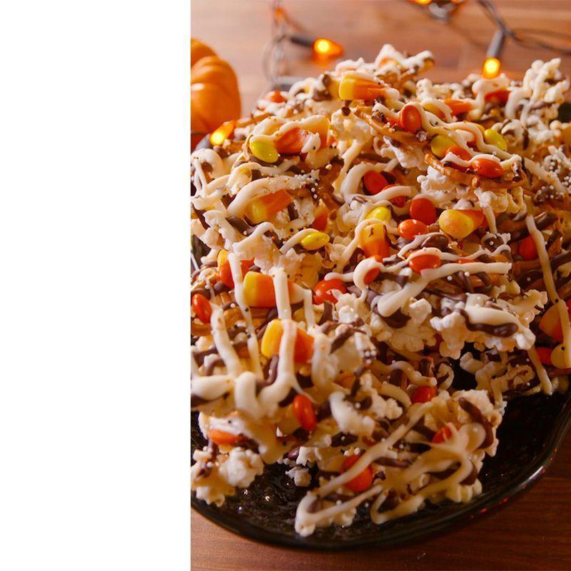 """<p>Even this tasty treat can't keep the monsters in a bad mood. The perfect app for those party guests that have a never ending sweet tooth. </p><p><em>Get the recipe at <a href=""""https://www.delish.com/cooking/recipe-ideas/recipes/a49572/monster-munch-recipe/"""" rel=""""nofollow noopener"""" target=""""_blank"""" data-ylk=""""slk:Delish"""" class=""""link rapid-noclick-resp"""">Delish</a>.</em></p>"""