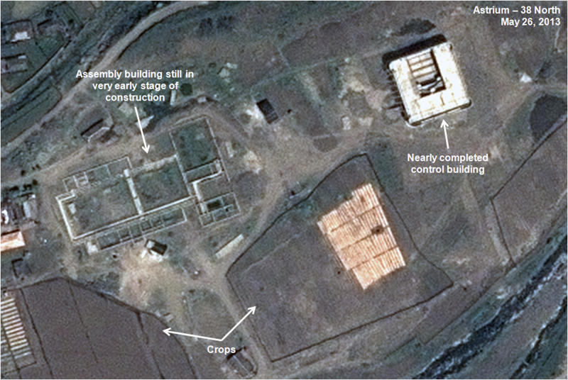 This May 26, 2013 satellite image taken by Astrium, and annotated and distributed by 38 North shows an unfinished new missile assembly building, top left, and control center, top right, at the Tonghae facility in North Korea. An eight-month construction standstill at the North Korean site meant to launch bigger and better long-range rockets may signal Pyongyang is slowing or even stopping development of larger rockets, according to a new analysis of recent satellite imagery. (AP Photo/Astrium - 38 North) CREDIT MANDATORY