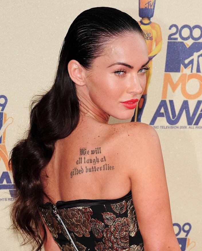 """Megan Fox famously had wrist tattoo of Marilyn Monroe removed—but she kept one major one. It reads: """"We will all laugh at gilded butterflies."""" Oh, and it's a quote from """"King Lear."""" How literary!"""