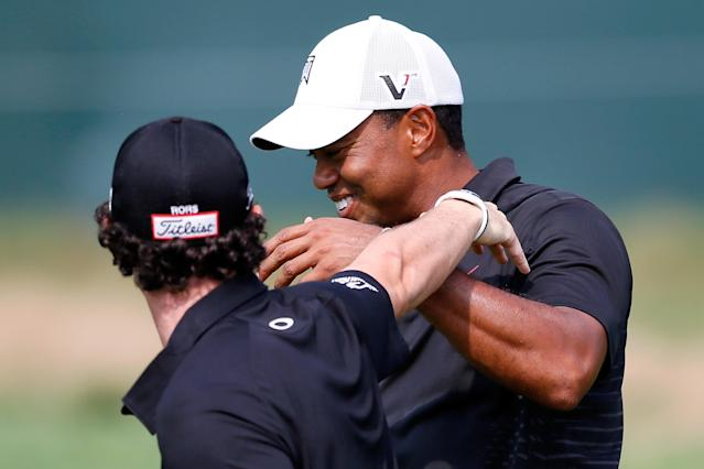 FARMINGDALE, NY - AUGUST 23: Tiger Woods (R) and Rory McIlroy of Northern Ireland joke around on the course as they walk up the 18th hole fairway during the First Round of The Barclays on the Black Course at Bethpage State Park August 23, 2012 in Farmingdale, New York. (Photo by Kevin C. Cox/Getty Images)