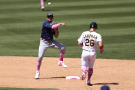 Tampa Bay Rays' Willy Adames, left, throws to first as Oakland Athletics' Matt Chapman goes into second base on a double play hit by Seth Brown during the sixth inning of a baseball game in Oakland, Calif., Sunday, May 9, 2021. (AP Photo/Jed Jacobsohn)