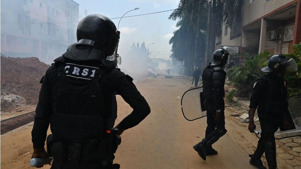 Ivorian anti-riot police use tear gas to disperse opposition supporters in Blockhauss, Abidjan.