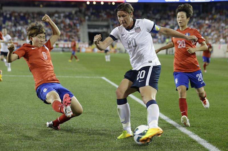 United States' Abby Wambach, center, tries to control the ball as South Korea's Lim Seonjoo, left, and Kim Hyeri defend during the second half of an international friendly soccer match at Red Bull Arena, Thursday, June 20, 2013, in Harrison, N.J. The U.S. won 5-0. (AP Photo/Julio Cortez)