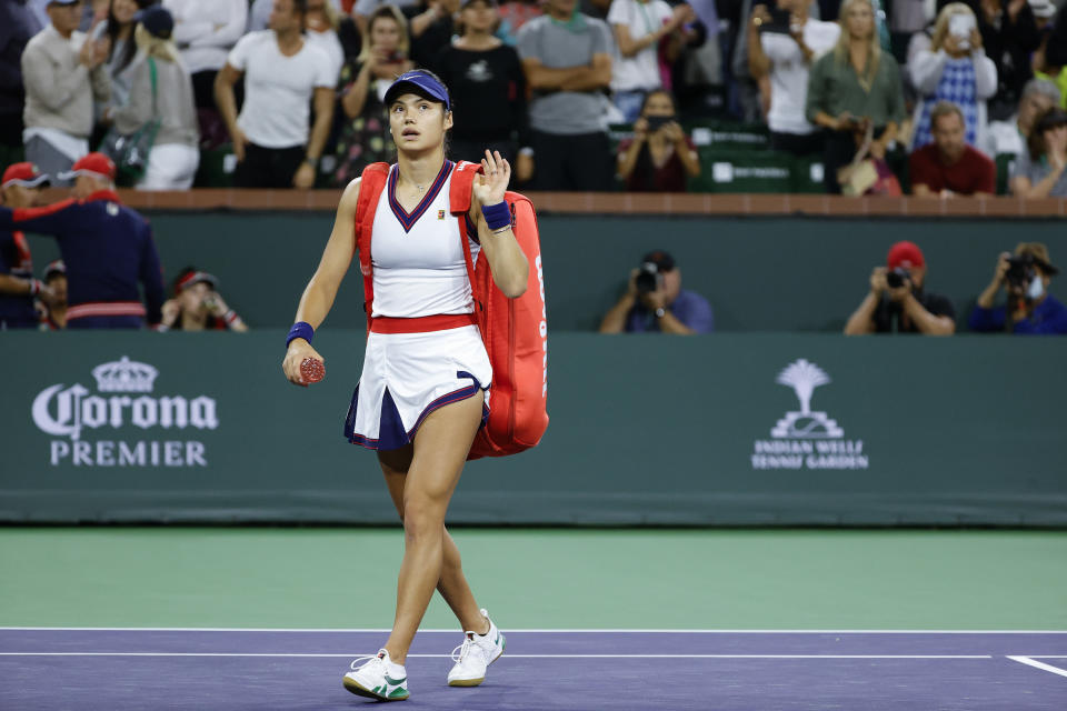 Seen here, Britain's Emma Raducanu walks off the court after losing in her first match at Indian Wells.