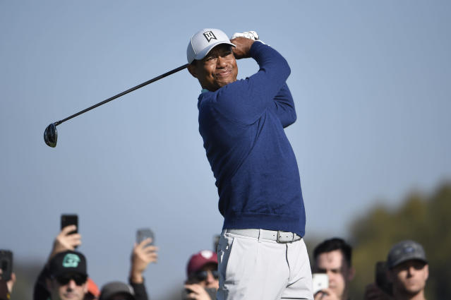 Tiger Woods hits his tee shot on the second hole of the South Course at Torrey Pines Golf Course during the third round of the Farmers Insurance golf tournament Saturday Jan. 25, 2020, in San Diego. (AP Photo/Denis Poroy)