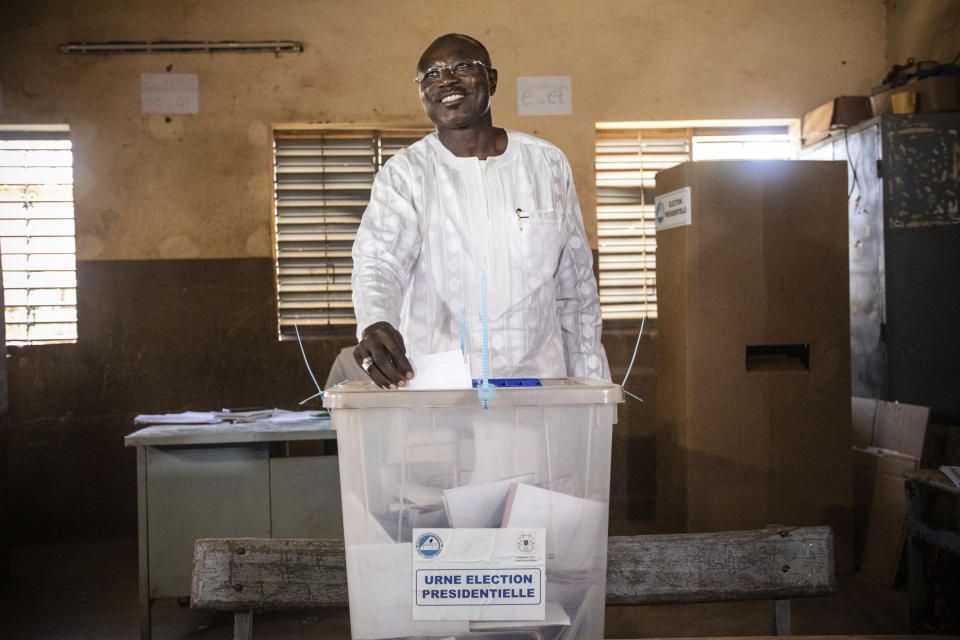 Burkina Faso opposition candidate Eddie Komboigo casts his ballot in the presidential and legislative elections in Ouagadougou, Sunday Nov. 22, 2020. Voters went to the polls Sunday in Burkina Faso for presidential and legislative elections that have been marred by ongoing extremist violence in this landlocked West African nation. President Roch Marc Christian Kabore has promised to secure the country and is vying for another five years against 12 other candidates. Kabore is expected to win, but the opposition hopes to take the vote to a second round. (AP Photo/Sophie Garcia)