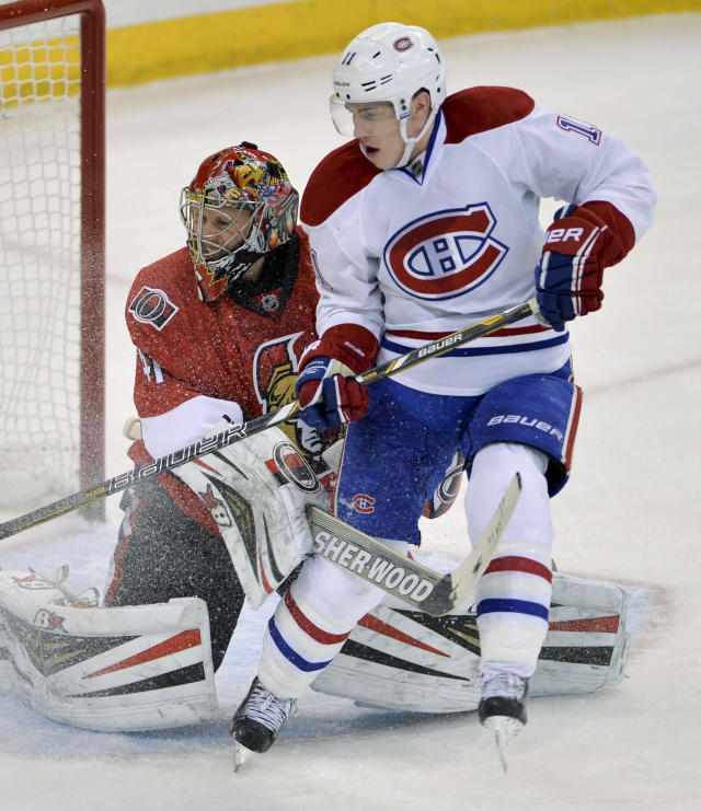 Montreal Canadiens right wing Brendan Gallagher pressures Ottawa Senators goalie Craig Anderson during the second period of an NHL hockey game Thursday, Jan. 16, 2014, in Ottawa, Ontario. (AP Photo/The Canadian Press, Adrian Wyld)