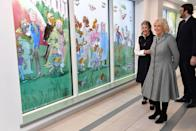 <p>For a visit to Birmingham Children's Hospital, Camilla wore an A-line, checkered coat with a blue brooch and black boots. </p>