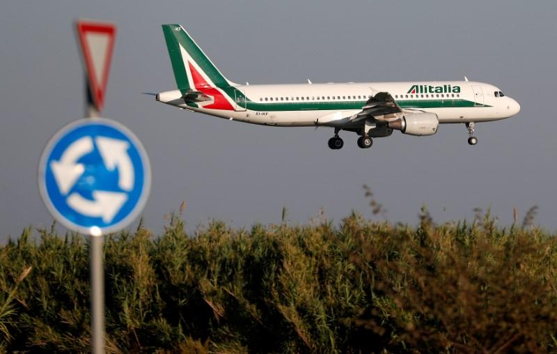 FILE PHOTO: An Alitalia Airbus A320 airplane approaches to land at Fiumicino airport in Rome