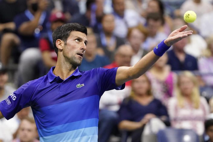 Novak Djokovic, of Serbia, serves against Jenson Brooksby, of the United States, during the fourth round of the U.S. Open tennis championships, Monday, Sept. 6, 2021, in New York. (AP Photo/John Minchillo)
