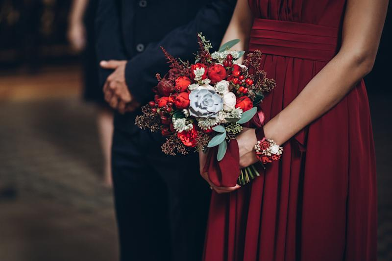 bridesmaid holding rustic bouquet with groomsman, couple in church during wedding ceremony, religion traditions