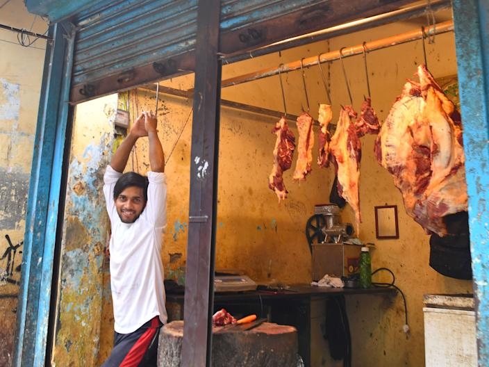 A butcher waits for customers at his meat shop in Dharavi slums, in Mumbai on June 24, 2020. (Photo by INDRANIL MUKHERJEE / AFP) (Photo by INDRANIL MUKHERJEE/AFP via Getty Images)
