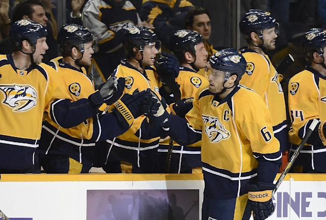 Nashville Predators defenseman Shea Weber (6) celebrates with his team after scoring a goal against the New Jersey Devils in the first period of an NHL hockey game on Friday, Jan. 31, 2014, in Nashville, Tenn. (AP Photo/Mark Zaleski)
