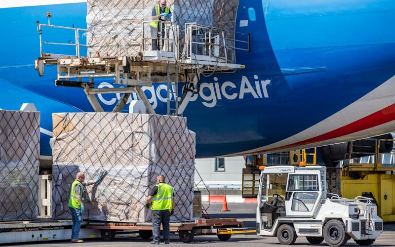 CargoLogicAir flight CLU 5694 lands at Prestwick Airport on Monday this week with a consignment of NHS medical supplies and PPE from China - PA