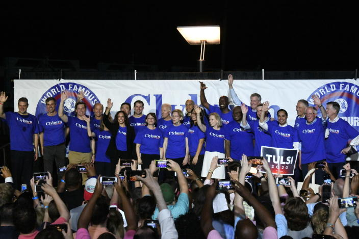 "Twenty-one of the Democrats seeking the party's presidential nomination pose together after House Majority Whip Jim Clyburn's ""World Famous Fish Fry,"" Friday, June 21, 2019, in Columbia, S.C. (AP Photo/Meg Kinnard)"
