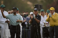 Gary Player, center, and Jack Nicklaus applaud as Lee Elder, left, waves before the ceremonial first tee shot at the Masters golf tournament on Thursday, April 8, 2021, in Augusta, Ga. (AP Photo/Matt Slocum)