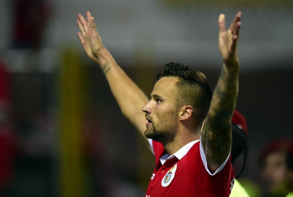 Benfica's Swiss forward Haris Seferovic celebrates after scoring a goal during the Portuguese league football match between GD Chaves and SL Benfica (AFP Photo/MIGUEL RIOPA)