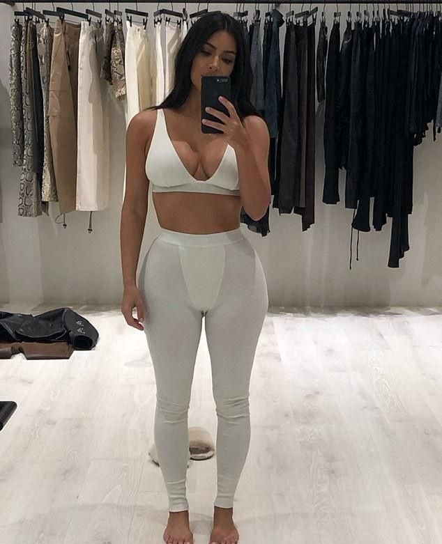 Kim Kardashian takes a selfie in a bra and leggings