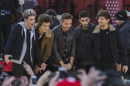 Members of the band One Direction stand together during their performance on ABC's Good Morning America inside Central Park in New York