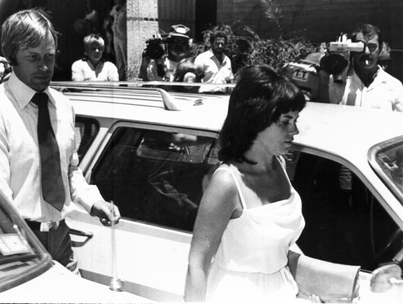 FILE - In this Feb. 2, 1982, file photo, Michael, left, and Lindy Chamberlain leave a courthouse in Alice Springs, Australia. A coroner found Tuesday, June 12, 2012, that a dingo took the Chamberlain's baby who vanished in the Australian Outback more than 32 years ago in a notorious case that split the nation over suspicions that the infant was murdered. (AP Photo/File)