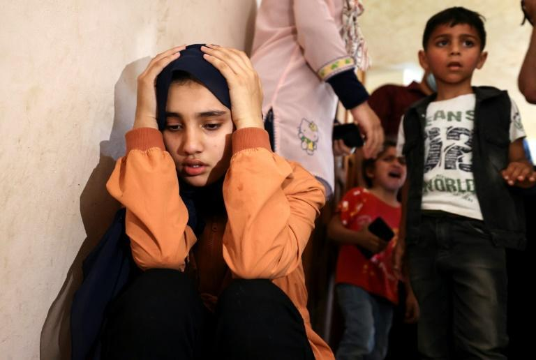 Relatives of Palestinian Hussein Hamad, 11, mourn during his funeral in Beit Hanun