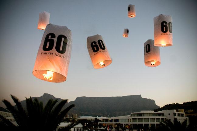 Seven lanterns released over the City of Cape Town, Republic of South Africa, (in front of Table Mountain) symbolizing the seven continents taking part in this global call to action on climate change to mark Earth Hour 2010.