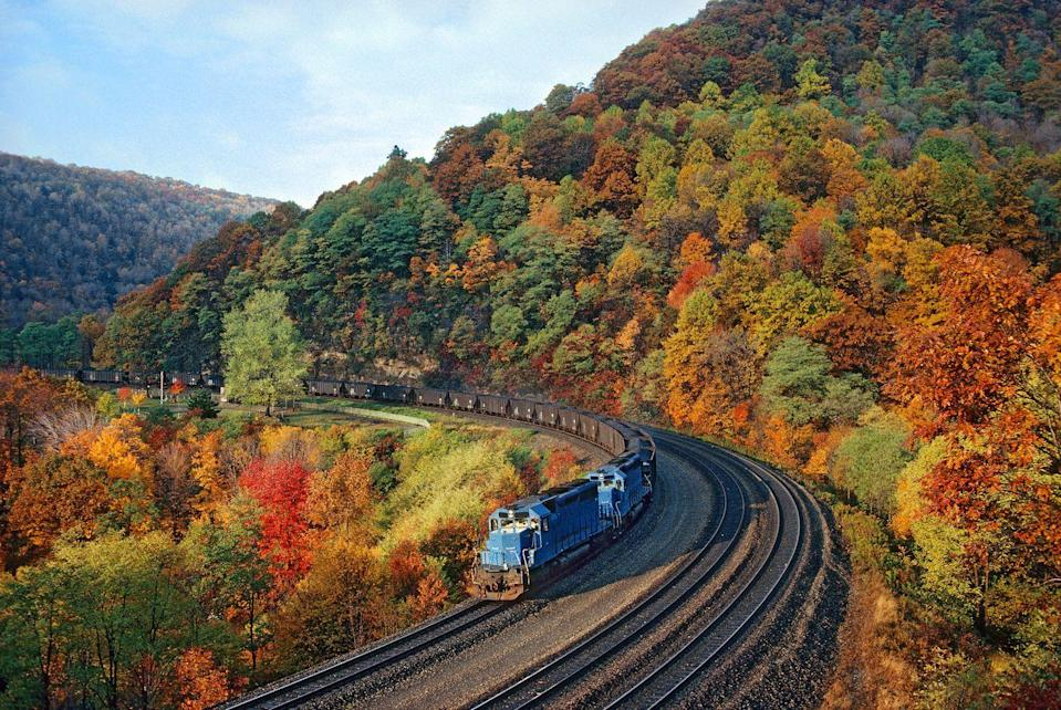"""<p>One of the most unique ways to enjoy Pennsylvania's autumn spectacle is by taking a train ride along the famous Horseshoe Curve in Altoona. You can also take in the gorgeous view by riding the funicular at the <a href=""""https://www.railroadcity.org/"""" rel=""""nofollow noopener"""" target=""""_blank"""" data-ylk=""""slk:Railroaders Memorial Museum"""" class=""""link rapid-noclick-resp"""">Railroaders Memorial Museum</a>. </p><p><a class=""""link rapid-noclick-resp"""" href=""""https://go.redirectingat.com?id=74968X1596630&url=https%3A%2F%2Fwww.tripadvisor.com%2FHotels-g30034-Altoona_Pennsylvania-Hotels.html&sref=https%3A%2F%2Fwww.thepioneerwoman.com%2Fhome-lifestyle%2Fg36804013%2Fbest-places-to-see-fall-foliage%2F"""" rel=""""nofollow noopener"""" target=""""_blank"""" data-ylk=""""slk:FIND A HOTEL"""">FIND A HOTEL</a></p>"""