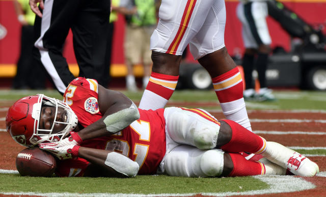 <p>Kansas City Chiefs running back Kareem Hunt (27) pretends to sleep on the ball as he celebrates a touchdown during the second half of an NFL football game against the Philadelphia Eagles in Kansas City, Mo., Sunday, Sept. 17, 2017. (AP Photo/Ed Zurga) </p>